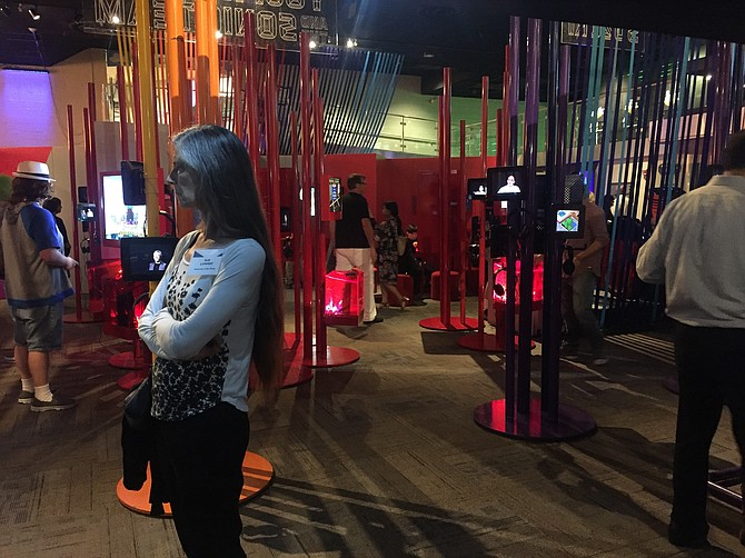 Museum goers experiencing Game Masters: The Exhibition