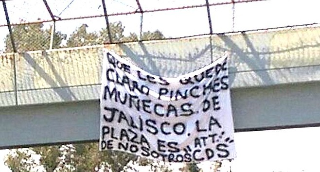 "On June 30th, on a pedestrian bridge a narco-banner threat read ""Let it be clear you sissy dolls from Jalisco, the plaza is ours."""