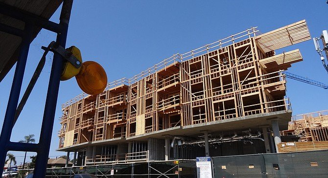 Texas St. side.  The five-story structure will contain 118 rental units, ranging from studio to two-bedroom.