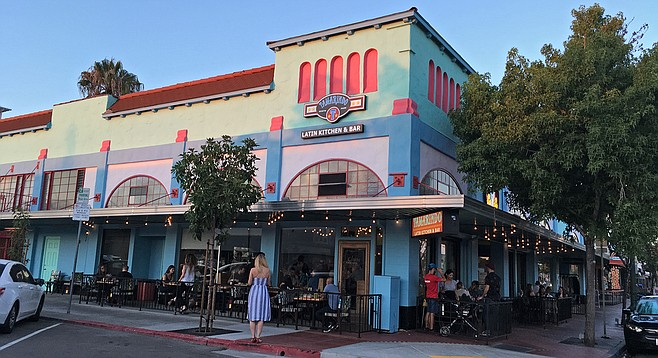 A colorful exterior draws a Friday-night crowd to Tamarindo