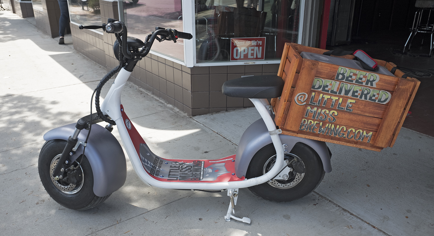 Little Miss Brewing's electric scooter delivers growlers within 2.5 miles of its Normal Heights tasting room.