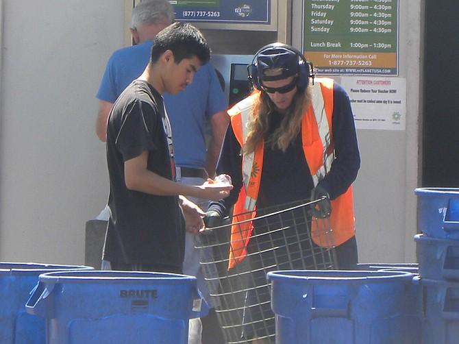A hard-working employee in Escondido helps a customer.