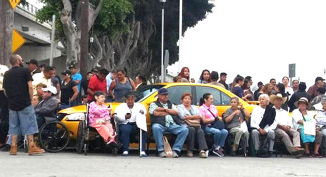 The union placed family members in front of their taxis — women, children, elderly — and said they wouldn't move unless physical force was used.