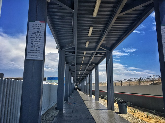 A long open hallway follows the Tijuana river, directly underneath the bridge that connects to PedWest.