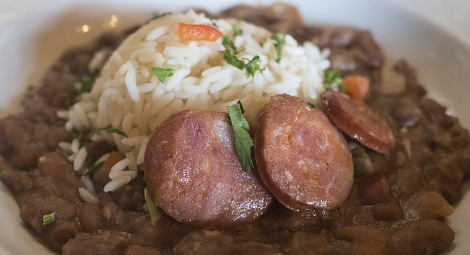 The favorite: K Paul andouille sausage medallions on top of red beans and rice
