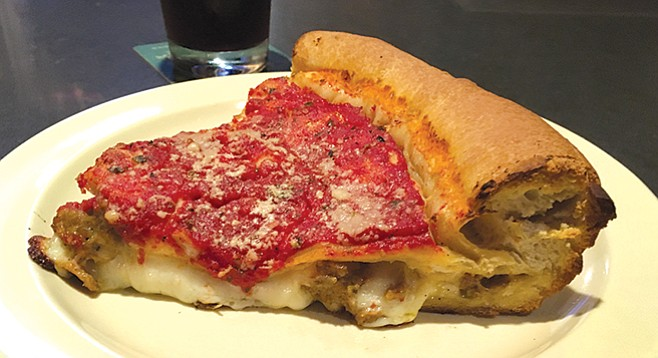Regents Pizzeria. Great flowing gobs of cheese, studded with great gobs of sausage — seriously big chunks.