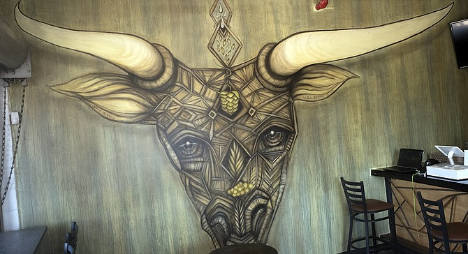 Alta brewing's tasting room is dominated by this mural by local artist Gloria Muriel.