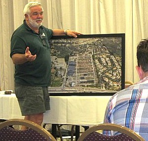The planning meeting was packed — Collins brought a large framed aerial photo from his office wall.