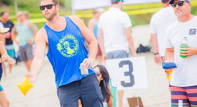 Even at the American Cornhole Championships, players commonly have a beer in one hand.