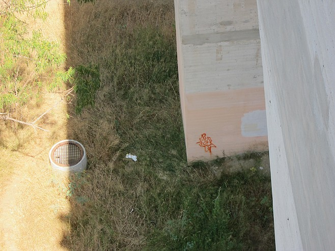 Manhole at the base of the bridge.