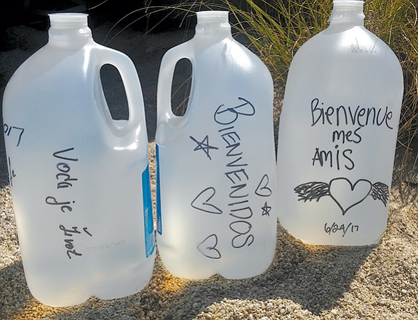 Water bottles with messages from June 24 drop