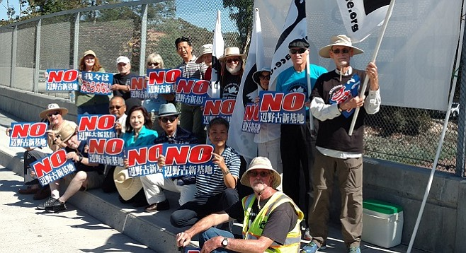 Military protesters including Veterans for Peace's Dave Patterson (front, right) and Japanese Councillor Keiko Itokazu (turquoise blouse, center front)