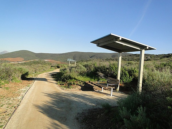 Four shade structures are along the trail with benches and space to accommodate wheelchairs.