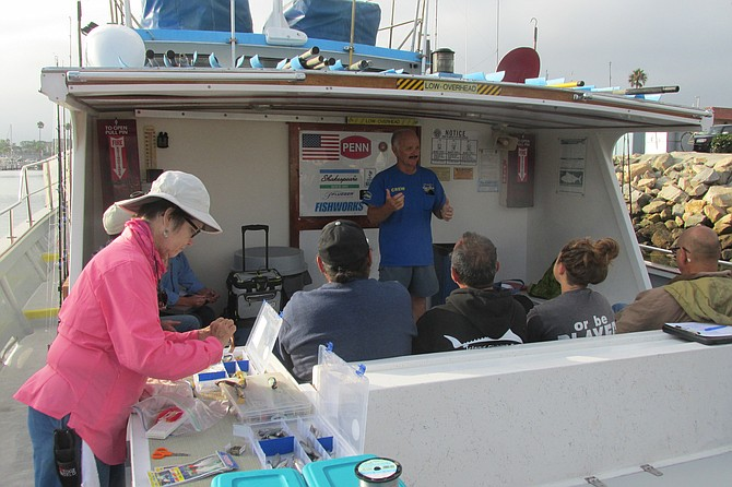 Volunteer anglers listen to fish data collection instructions by Capt. Joe Cacciola.