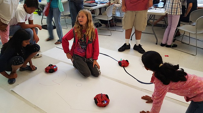 Girls working with Parallax S2 Robots