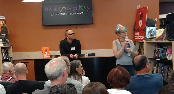 Yturralde (right) fields questions from an author meet-and-greet featuring Cory Doctorow (center) in May 2017