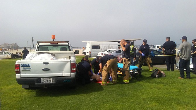 Victim receiving medical attention at the scene of the incident