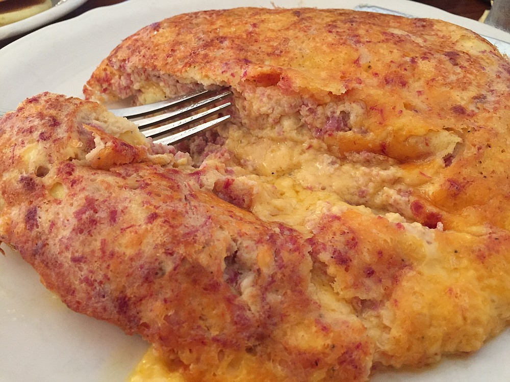 The Irish Omelette, named for the savory corned beef, onion, and potato medley