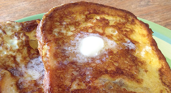 French toast is fully inch-thick, drowning in butter.