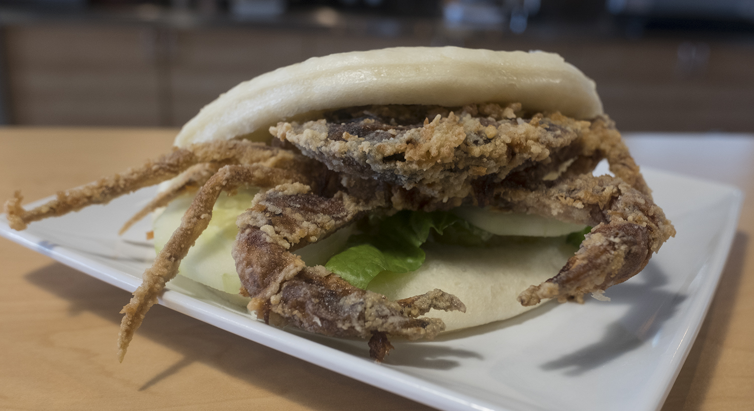 Soft shell crab, tempura fried and served in a bao