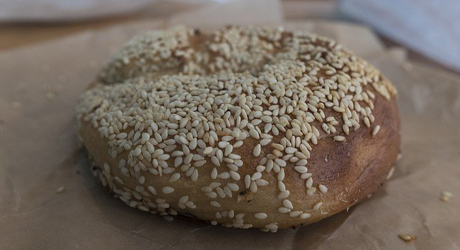 A Montreal-style sesame bagel, wood-fired at the new Nomad Donuts location.
