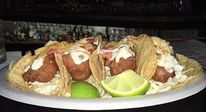 Two Baja-style tacos will fill you up. So it kinda stinks that you have to order a minimum of four to get the deal.