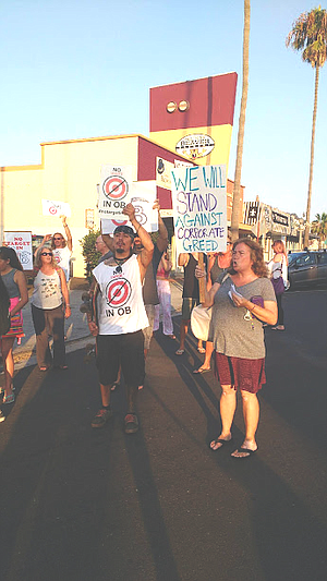 """They've already kicked out enough mom-and-pop businesses in O.B.,"" said a protester."