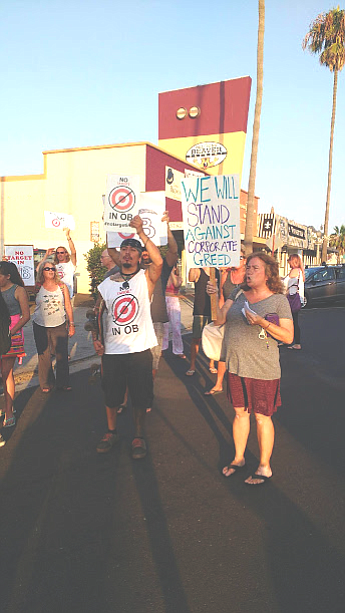 """""""They've already kicked out enough mom-and-pop businesses in O.B.,"""" said a protester."""