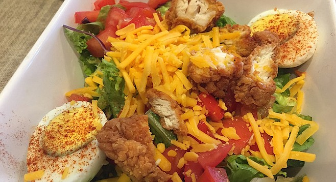 Simple cheddar, hunks of ripe tomatoes on greens, served with a hardboiled egg, and of course the fried chicken.