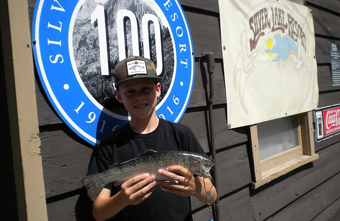 Chase Johnson from Encinitas landed this nice 1 pound 12 ounce Rainbow fishing from the shore of Silver Lake using Garlic Power Bait