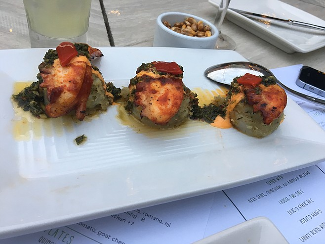 The grilled octopus appetizer at Pisco is served on top of chimichurri potatoes.