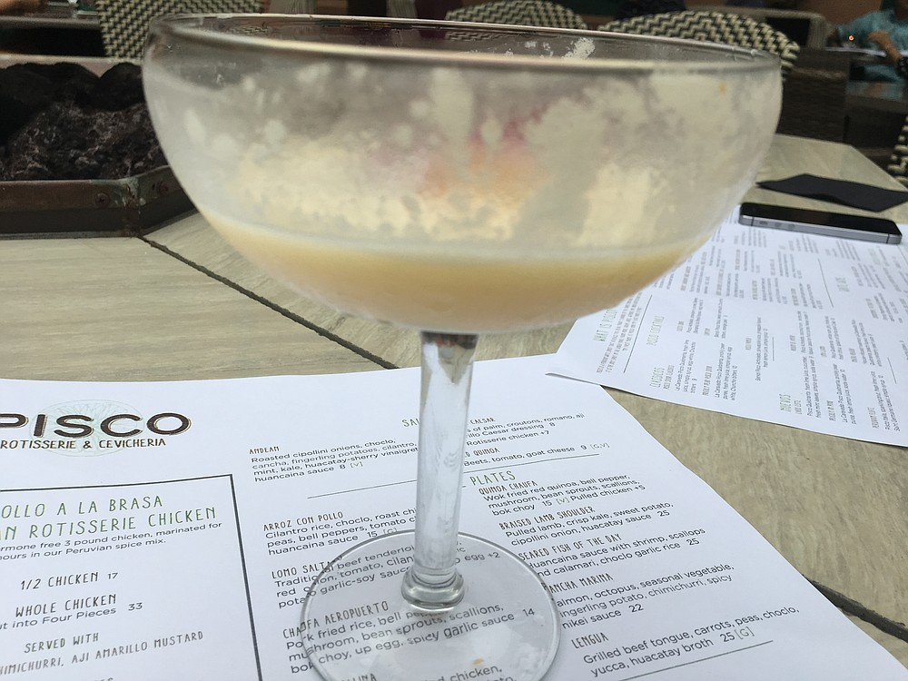 Pisco is a brandy made in Peru. The Pisco sour is a cocktail made with the spirit and egg whites. On a hot day, it's easy to drink one before you realize it's time to take a photo.