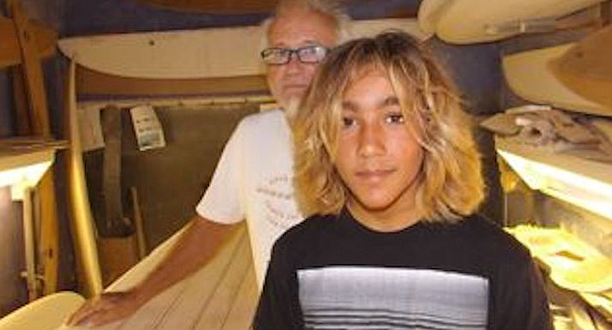 13-year-old Zach Flores with master shaper Jim Phillips in Phillips' Encinitas shaping room.