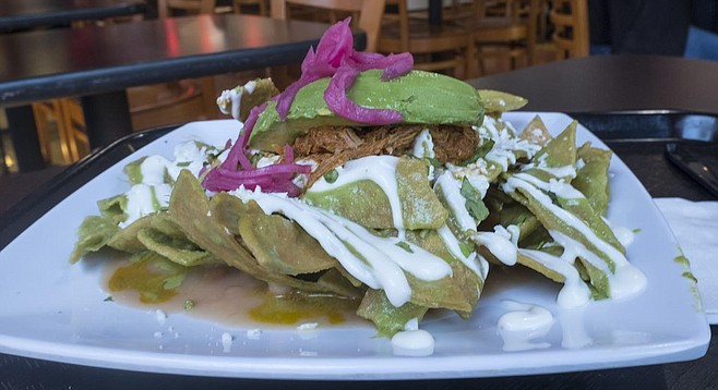Avocados and pickled onions add color to La bomba chilaquiles.