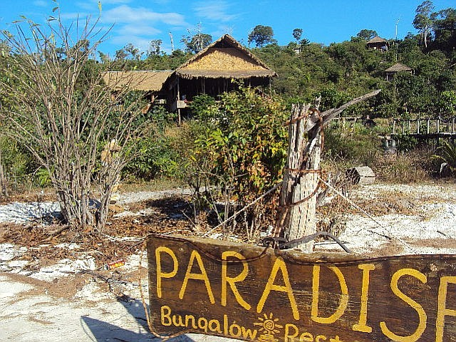 Paradise Bungalows's entrance from the beach.