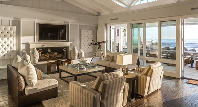 If staring at the ocean gets boring, motorized drapes and sun shades in every room.