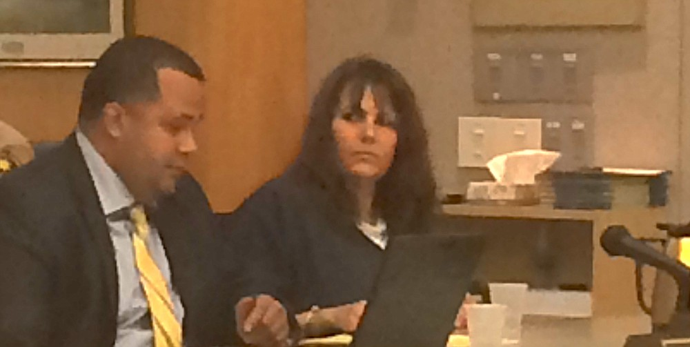 Suspect Sarah Marie Riley and her lawyer