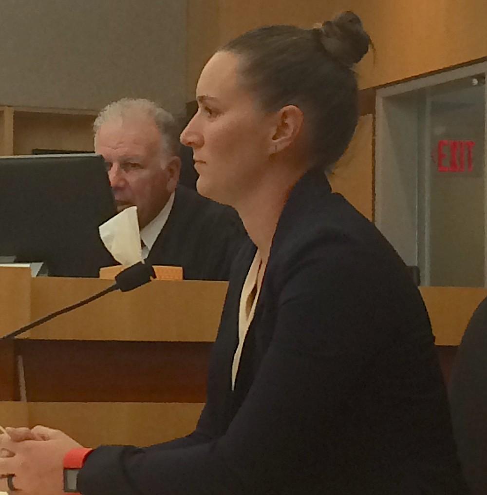 Deputy Jessica Caporaso rewound surveillance video to see Riley break a broomstick over a cellmate's head.