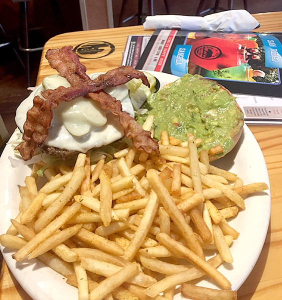 Cali Comfort: The Aztec — guacamole on one side, jalapeno slices on the other