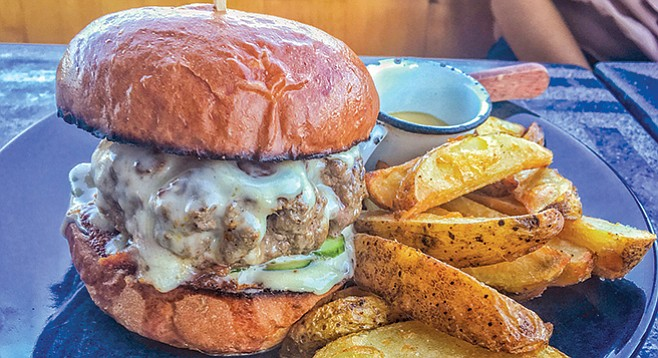 Cafe Tonala Burger.The patty is chunky and juicy made with 180 grams (about a ⅓ of a pound) of ground beef.