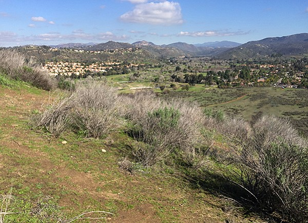 The views of San Miguel Peak, the refuge to the west, and the Sweetwater River's lush green valley are worth the short climb.
