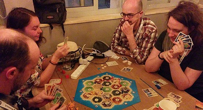 Adults playing Catan without irony