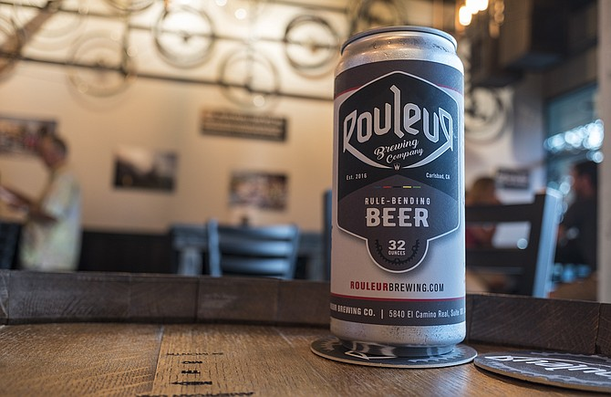 32 ounces of beer canned on demand by Rouleur Brewing's crowler machine.