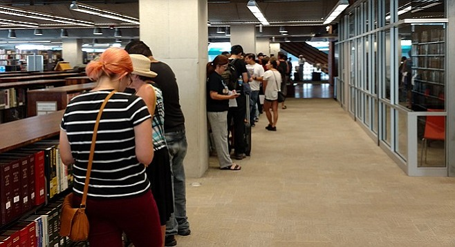 People lined up to get their hepatitis A shot at one of several pop-up clinics hosted by the central library