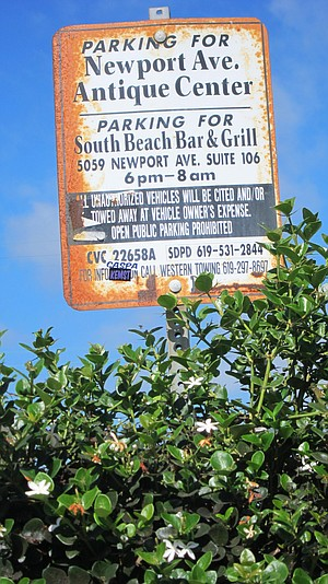 One rusty sign notes the parking available to South Beach patrons.