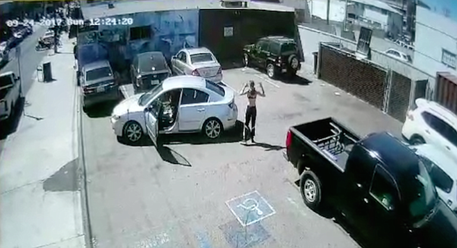 Security camera recorded the driver getting out of her car before she keyed another car.