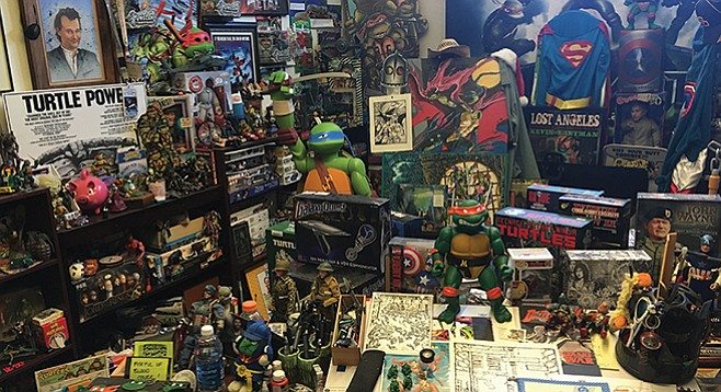 Kevin Eastman (upper left) looks down upon a re-creation of his turtle-infested studio at the San Diego Comic Art Gallery.