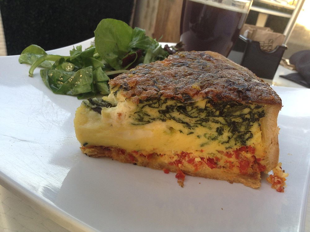 Quiche aux Epinards —  bursting out of the spinach, white, crumbly goat cheese.