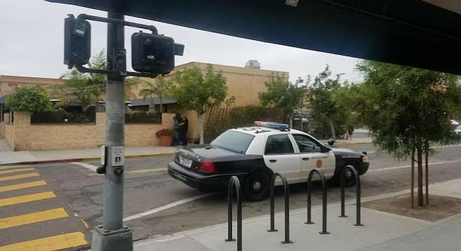 Police making arrest outside Adams Avenue rec center