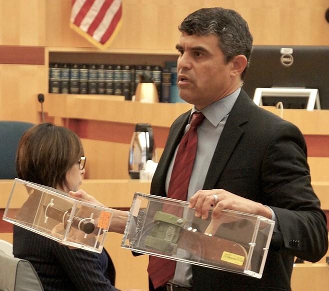 Prosecutor Pat Espinoza showed the Ka-Bar knife and sheath to the jury.